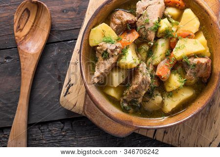 Irish Stew Food. Irish Dinner. Beef Meat Stewed With Potatoes, Carrots And Soda Bread On Wooden Back