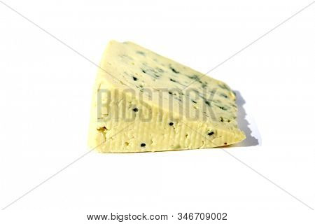 Blue Cheese. Delicious Amish Blue Cheese. Isolated on white. Room for text. Clipping Path. People world wide love Blue Cheese. Exotic Cheeses are always in demand for find dinning and snacking.