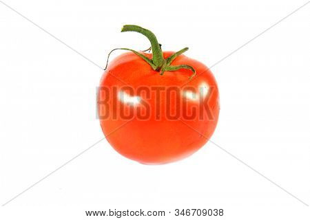 Red Tomato. A ruby red Beef Steak Tomato. Isolated on white. Room for text. Clipping Path. Tomato's are enjoyed by humans world wide in many various forms. Good for soups to sandwiches. Enjoy one now.