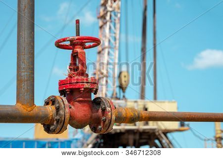 Close-up Of The Valve Plug An Oil Pipeline In The Field On A Sunny Summer Day. Offshore The Industry