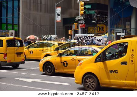 New York, Usa - July 10, 2019: Yellow Cab Cars In Traffic On Times Square In Manhattan, New York, Us