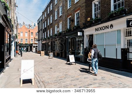 London, Uk - May 15, 2019: Shopping Street With Fashion Stores In Soho Near Carnaby Street. Carnaby