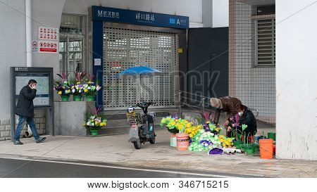 Wuhan China , 24 January 2020 : Closed Subway Station And People Wearing Masks During Second Day Of