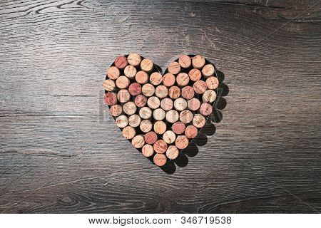 Big Heart Made Of Wine Corks. Flat Lay On Wooden Rustic Background. 14 February. Passion, Love And F