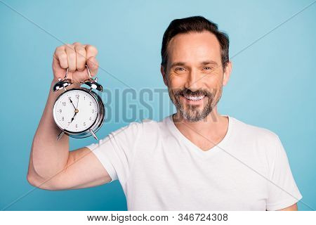 Close-up Portrait Of Nice Attractive Cheerful Cheery Glad Guy Holding In Hand Clock Healthy Sleep Dr