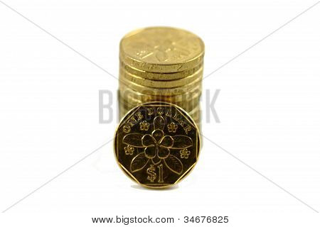 Stack of golden 1 dollar Singapore coins