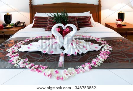 Romantic Bedroom Interior, Kissing Swan Origami Towels And Sprinkled Fresh Pink White Rose Flower Pe
