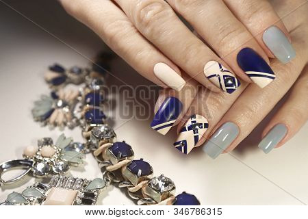 Graphic Nail Design On Beige, Transparent Blue And Dark Matte Blue Nail Polish With Metallic Rhinest