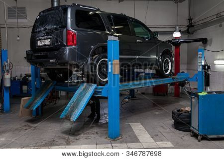 Novosibirsk, Russia - 08.01.2018: Used Gray Car Infiniti Qx56 Stands On The Stand Wheel Alignment Co