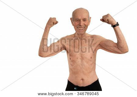 Half Lenght Portrait Of The Happy Shirtless Old Man, Senior Showing His Biceps And Looking At The Ca