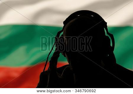 Silhouette Of A Man With Headphones On The Background Of The Flag Of Bulgaria, Eavesdropping On A Co
