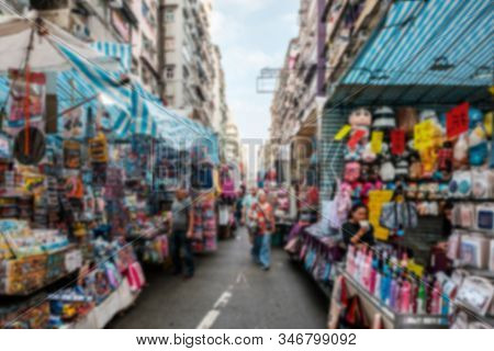 Abstract, Blurred Concept Image Of People On Street Market In Hong Kong , Tung Choi Street -