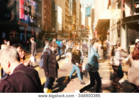 Blurry Image Of Unrecognizable People Crossing Street In Hong Kong