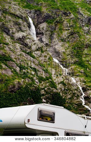Camper Car Motorhome With Alcove On Roadside In Mountains. Camping On Trip. Norway Scandinavia Europ