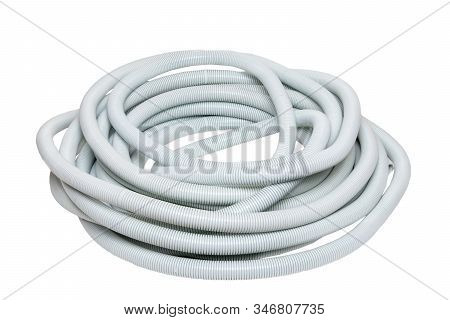 Plastic Hose Isolated. Close-up Of A Roll Of Light Gray Industrial Flexible Plastic Corrugated Pipe