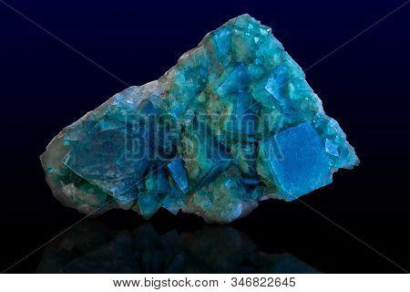Rock Of Blue Calcite Mineral On Dark Background