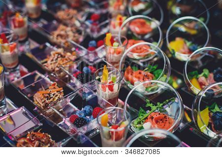 Beautifully Decorated Catering Banquet Table With Different Food Snacks And Appetizers On Corporate