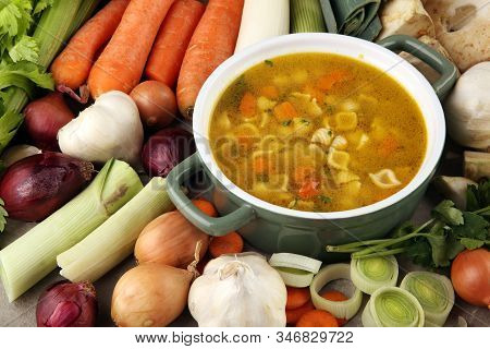 Broth With Noodles And Carrots, Various Fresh Vegetables In A Pot - Colorful Fresh Clear Spring Soup