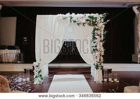 Wedding Photozone. White Photozone With Flowers And Candies In Glass. Wedding Flowers Decoration In