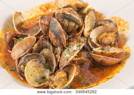 Detail Of A Dish Of Clams In Red Sauce