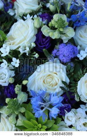 White And Blue Flower Arrangement For A Wedding: White Roses And Blue Larkspur