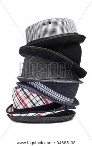 stack of different and trendy hats on a white background