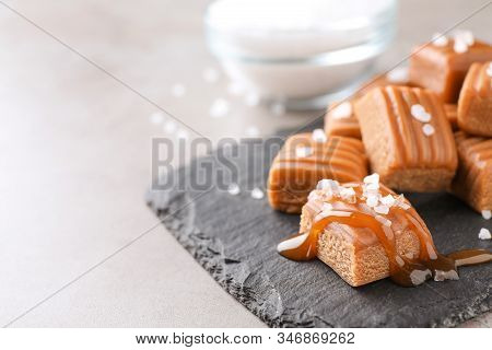 Salted Caramel On Light Grey Table, Closeup. Space For Text