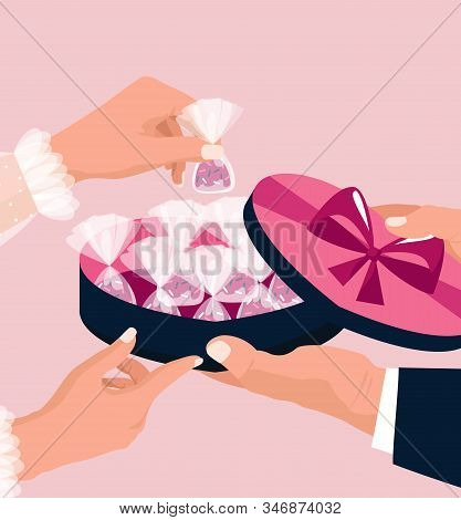 Valentines Day Concept. A Man Gives A Box Of Heart-shaped Chocolates To A Woman. February 14. Pink B