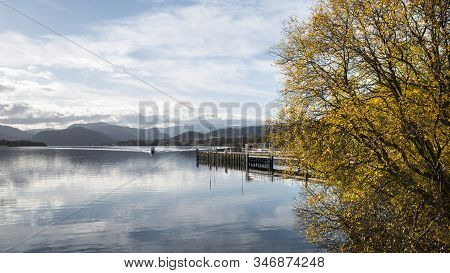 Epic Autumn Fall Landscape Of Ullswater And Surrounding Mountains And Hills Viewed From Hallin Fell