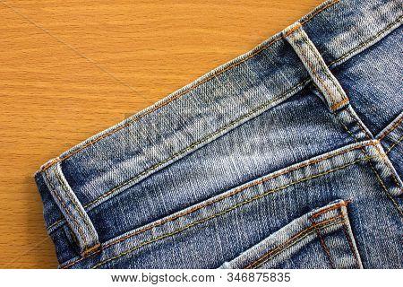 Jeans Texture. Empty Denim On Wood Background