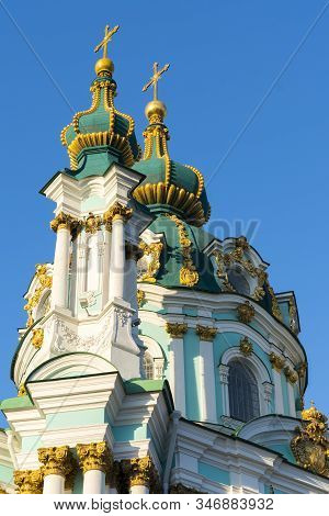 Orthodox Temple With Golden Baths On A Blue Background. The Concept Of Orthodoxy. Vertical Photo