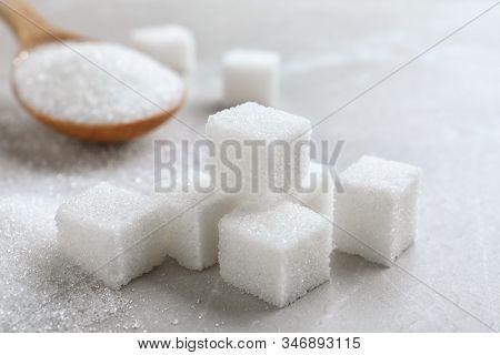 Heap Of Refined Sugar Cubes On Light Grey Table, Closeup