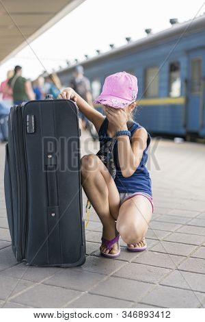 Kid Crying To Lost Parent Or Live Alone On Sky Train Station. Little Girl Lost At The Train Station