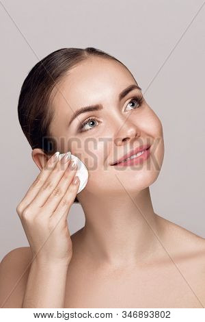 Woman Cleaning Face With White Pad. Beautiful Girl Removing Makeup White Cosmetic Cotton Pad. Happy