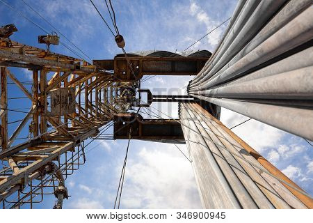 Oil And Gas Drilling Rig. Oil Platform Isolated On White Background. Drilling Rig In Oil Field For D