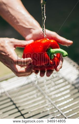 Two Hands Clean And Wash The Raw Peppers. Healthy Food To Stay In Shape And For Vegan And Vegetarian