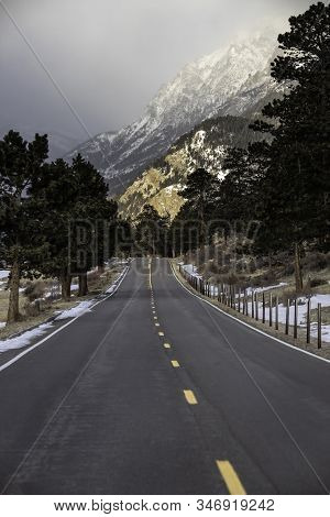 The Road Traveling Past Sheep Lakes As It Winds Through The Mountains In Rocky Mountain National Par