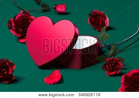 Red Gift Box In The Form Of Heart With Blank Cover, Near Roses. Surprise For Saint Valentine Day, 3d