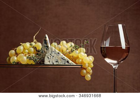 Grapes With Blue Cheese And Thyme. Glass Of White Wine With Snacks. Copy Space.