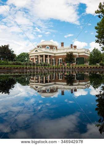 Beautiful Jefferson Monticello Mansion Reflecting In Pool With Clouds Hanging Above On Sunny Day. Re