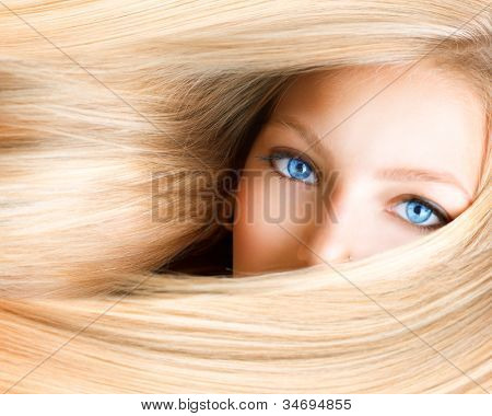 Blond Girl. Blonde Woman with Blue Eyes. Healthy Long Blond Hair. Hair Extension