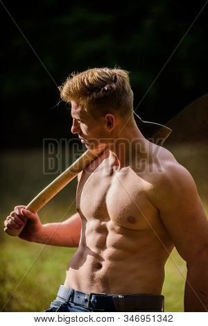 Strength And Power Concept. Forester With Axe. Sexy Macho Bare Torso. Surviving In Wild Nature. Musc