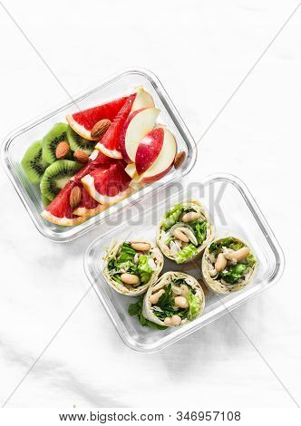 Healthy Diet Food Lunch Box - Fruit And Chicken, Beans, Green Salad Pita Bread On A Light Background