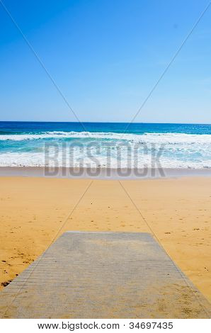 wooden Boardwalk on the beach and tropical sea