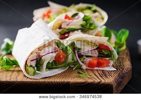 Fresh Tortilla Wraps With Chicken And Fresh Vegetables On Wooden Board. Chicken Burrito. Mexican Foo