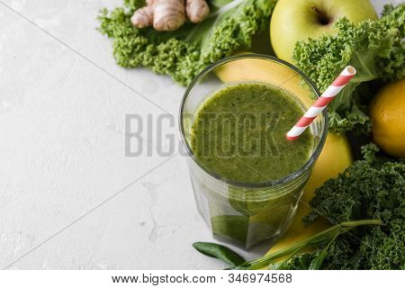 Freshly Prepared Glass Of Green Smoothie, Close-up. Fresh Vegetable Smoothie On A Light Background.