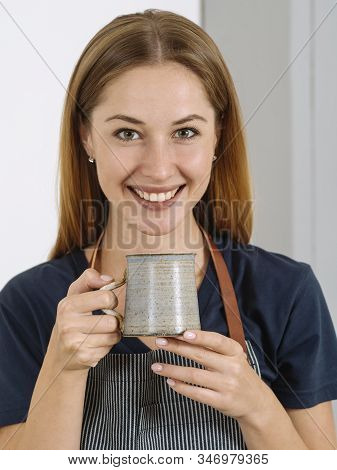 Happy And Smiling Gorgeous Woman Drinking Coffee In An Urban Caf