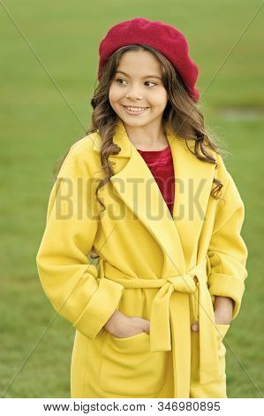 Feeling Cozy And Comfortable. Girl Fashionable Model Wear Yellow Wool Coat. Child In Warm Clothes. F