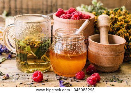 Herbal Tea, Honey And Raspberries On A Wooden Table, Alternative Medicine, Ayurveda, Dried Flowers