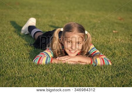 Living Happy Life. Cheerful Schoolgirl On Sunny Day. Happy Smiling Pupil. Have Fun. Girl Kid Laying